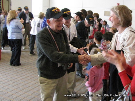 Old World War II veterans greeting passengers at Washington Dulles Airport