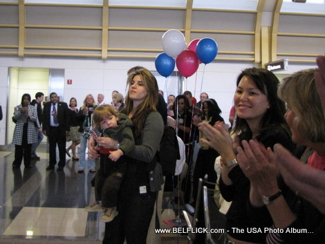 These are airport passengers at Washington Dulles Airport they are cheering away because...