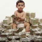 Money Baby Sitting On A Pile Of Cash